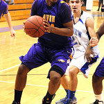 Avon Claude Gray goes to hoop past Midview JJ Manning in first half Feb. 15. Steve Manheim