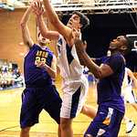 Midview Riley Moore drives to hoop between Avon Matt Haney, left, and Claude Gray Feb. 15. Steve Manheim/CT