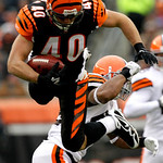 Cincinnati Bengals running back Brian Leonard (40) is tackled by Cleveland Browns safety T.J. Ward in the second half of an NFL football game, Sunday, Dec. 19, 2010, in Cincinnati. (AP Photo …