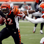 Cincinnati Bengals running back Cedric Benson (32) pushes off Cleveland Browns cornerback Joe Haden (23) in the second half of an NFL football game, Sunday, Dec. 19, 2010, in Cincinnati. Ben …