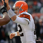 Cleveland Browns quarterback Colt McCoy is congratulated after throwing a 20-yard touchdown against the Cincinnati Bengals in the first half of an NFL football game, Sunday, Dec. 19, 2010, i …