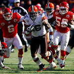 Cleveland Browns wide receiver Josh Cribbs (16) runs past Kansas City Chiefs kicker Ryan Succop (6) and linebacker Jovan Belcher (59) during the first half of an NFL football game Sunday, De …