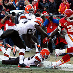 Kansas City Chiefs running back Jamaal Charles (25) gets into the end zone past several Cleveland Brown defenders during the first half an NFL football game on Sunday, Dec. 20, 2009, in Kans …