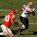 Cleveland Browns running back Jerome Harrison (35) gets past Kansas City Chiefs safety Mike Brown (30) for a short gain during the second quarter of NFL an football game Sunday, Dec. 20, 200 …