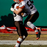 Cleveland Browns wide receiver Josh Cribbs, left, celebrates with linebacker Blake Costanzo (54) after returning a kickoff 100 yards for a touchdown during the first quarter of an NFL footba …