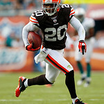 Cleveland Browns cornerback Mike Adams (20) intercepts a pass thrown by Miami Dolphins quarterback Chad Henne in the fourth quarter during an NFL football game in Miami, Sunday, Dec. 5, 2010 …