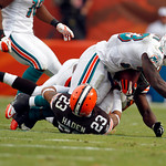 Miami Dolphins running back Ronnie Brown, top, is tackled by Cleveland Browns cornerback Joe Haden, bottom, in the third quarter during an NFL football game in Miami, Sunday, Dec. 5, 2010. ( …