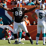 Cleveland Browns defensive tackle Shaun Rogers (92) celebrates after blocking a field goal-attempt by Miami Dolphins kicker Dan Carpenter (5) in the first quarter during an NFL football game …