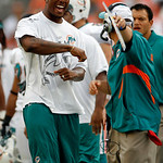 Miami Dolphins wide receiver Brandon Marshall, left, reacts on the sidelines to a penalty called against his team in the fourth quarter during an NFL football game against the Cleveland Brow …