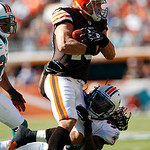 Cleveland Browns running back Peyton Hillis, top, is tackled by Miami Dolphins safety Chris Clemons, bottom, in the first quarter during an NFL football game in Miami, Sunday, Dec. 5, 2010. …