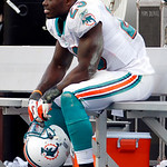 Miami Dolphins running back Ronnie Brown sits on the bench after the Cleveland Browns defeated the Dolphins 13-10 in an NFL football game in Miami, Sunday, Dec. 5, 2010. (AP Photo/J Pat Cart …