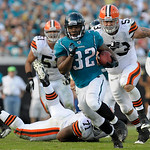 Jacksonville Jaguars running back Maurice Jones-Drew (32), center, breaks free for a 75-yard run past Cleveland Browns defensive tackle Ahtyba Rubin (71), linebacker Chris Gocong (51) and li …