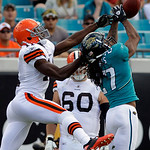 Jacksonville Jaguars cornerback Rashean Mathis, right, breaks up a pass intended for Cleveland Browns wide receiver Mohamed Massaquoi during the first half of an NFL football game in Jackson …
