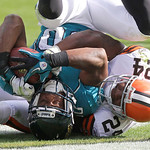 Jacksonville Jaguars wide receiver Mike Thomas goes upside down as he is tackled by Cleveland Browns corner back Sheldon Brown (24) after catching a five-yard touchdown pass late in the seco …