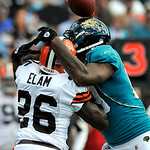 Jacksonville Jaguars tight end Marcedes Lewis, right, and Cleveland Browns safety Abram Elam (26) battle for the ball during the first half of an NFL football game, Sunday, Nov. 21, 2010, in …