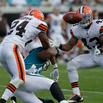 Cleveland Browns safety T.J. Ward (43) intercepts a pass after cornerback Sheldon Brown (24) knocked the ball away from Jacksonville Jaguars wide receiver Mike Thomas, center, during the sec …