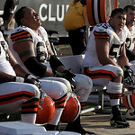 Cleveland Browns offensive linemen John St. Clair (78), left, guard Shawn Lauvao, second from left, center Alex Mack (55), second from right, and tackle Joe Thomas (73), right, sit on the be …