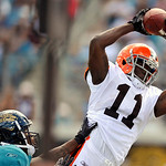Cleveland Browns wide receiver Mohamed Massaquoi (11) reaches for the ball against Jacksonville Jaguars cornerback Rashean Mathis (27) during the first half of an NFL football game, Sunday,  …