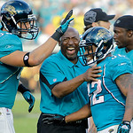 Jacksonville Jaguars running backs coach Earnest Byner, center, celebrates with running back Maurice Jones-Drew (32) and teammates Zach Potter, left, and Greg Jones, right, after Jones-Drew  …