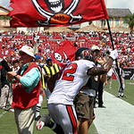 Tampa Bay Buccaneers tight end Kellen Winslow (82) runs on the field with a team flag before an NFL football game against the Cleveland Browns Sunday, Sept. 12, 2010, in Tampa, Fla. (AP Phot …