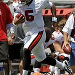 Tampa Bay Buccaneers quarterback Josh Freeman (5) sprints past Cleveland Browns linebacker Eric Barton (50) on a 33 yard first quarter run during an NFL football game Sunday, Sept. 12, 2010, …
