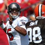 Tampa Bay Buccaneers quarterback Josh Freeman (5) throws a first half pass in front of Cleveland Browns defensive end Robaire Smith (98) during an NFL football game Sunday, Sept. 12, 2010, i …