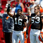 Cleveland Browns players, including Josh Cribbs (16) and Matt Roth (53) walk onto the field as a show of solidarity for the players union before an NFL football game against the Tampa Bay Bu …