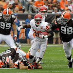 Kansas City Chiefs running back Thomas Jones (20) is tripped up by Cleveland Browns linebacker Eric Barton (50) as Scott Fujita (99) and defensive end Robaire Smith (98) give chase on a firs …