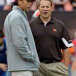 Kansas City Chiefs coach Todd Haley, left, talks with Cleveland Browns coach Eric Mangini before an NFL football game Sunday, Sept. 19, 2010, in Cleveland. (AP Photo/Mark Duncan)