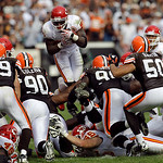 Kansas City Chiefs running back Thomas Jones leaps over the Cleveland Browns defensive line on fourth down late in the fourth quarter of an NFL football game Sunday, Sept. 19, 2010, in Cleve …