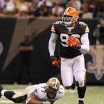 Cleveland Browns linebacker David Bowens (96) returns an interception for a touchdown as New Orleans Saints guard Carl Nicks (77) lies in the turf during the fourth quarter an NFL football g …