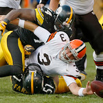 Cleveland Browns quarterback Derek Anderson (3), center, fumbles the ball as he is sacked by Pittsburgh Steelers linebackers James Farrior, bottom, and Lawrence Timmons in the third quarter …