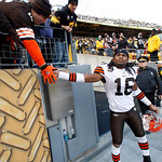 Cleveland Browns' Joshua Cribbs, right, greets a Browns fan after an NFL football game against the Pittsburgh Steelers in Pittsburgh,  Sunday, Oct. 18, 2009. The Steelers won 27-14. (AP Phot …