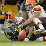 Pittsburgh Steelers running back Willie Parker, bottom, fumbles after he is hit by Cleveland Browns linebacker Eric Barton, right, and defensive back Brandon McDonald in the third quarter of …