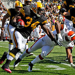 Pittsburgh Steelers running back Rashard Mendenhall (34) gets past Cleveland Browns defender Sheldon Brown (24) during the first quarter of an NFL football game in Pittsburgh, Sunday, Oct. …
