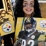 Pittsburgh Steelers fane Paige Stevenson of New Brunswick, Canada stands on the sidelines to watch warm ups before an NFL football game against the Cleveland Browns in Pittsburgh, Sunday, Oc …