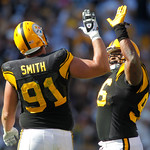 Pittsburgh Steelers defensive ends Aaron Smith (91) and Ziggy Hood (96) celebrate a sack against the Cleveland Browns in the third quarter of an NFL football game, Sunday, Oct. 17, 2010 in P …