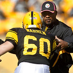 Pittsburgh Steelers head coach Mike Tomlin, right, plays defense during warmups against Steelers long snapper Greg Warren before the NFL football game against the Cleveland Browns, Sunday, O &#8230;