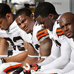 Cleveland Browns defensive back Mike Adams, right, sits with the Browns secondary as the team during the fourth quarter of an NFL football game, Sunday, Oct. 17, 2010, in Pittsburgh. The Ste …