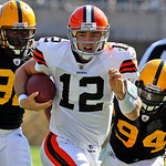 Pittsburgh Steelers defenders James Harrison, left, and Lawrence Timmons (94) chase Cleveland Browns quarterback Colt McCoy (12) as he scrambles out of the pocket during the first quarter of …