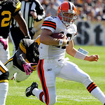 Cleveland Browns quarterback Colt McCoy (12) slides at the end of a run during the first quarter of an NFL football game against the Pittsburgh Steelers in Pittsburgh, Sunday, Oct. 17, 2010. …