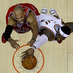 Chicago Bulls&#039; Taj Gibson, left, dunks against Cleveland Cavaliers&#039; LeBron James in the third quarter of Game 2 in the first round of the NBA basketball playoffs Monday, April 19, 2010, in C &#8230;
