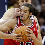 Chicago Bulls&#039; Joakim Noah (13) gets slapped in the face by Cleveland Cavaliers&#039; Zydrunas Ilgauskas, from Lithuania, in the first quarter of Game 2 in the first round of the NBA basketball p &#8230;