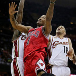 Chicago Bulls&#039; Derrick Rose (1) shoots between Cleveland Cavaliers&#039; Antawn Jamison and Anthony Parker (18) in the second quarter of Game 2 in the first round of the NBA basketball playoffs M &#8230;