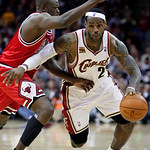Cleveland Cavaliers&#039; LeBron James, right, drives past Chicago Bulls&#039; Luol Deng, from Sudan, in the fourth quarter of Game 2 in the first round of the NBA basketball playoffs Monday, April 19 &#8230;