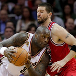Cleveland Cavaliers&#039; Shaquille O&#039;Neal, left, runs into Chicago Bulls&#039; Brad Miller in the second quarter of Game 2 in the first round of the NBA basketball playoffs Monday, April 19, 2010, in &#8230;