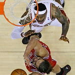 Chicago Bulls&#039; Joakim Noah, bottom, goes up for a shot against Cleveland Cavaliers&#039; LeBron James in the second half of Game 2 in the first round of the NBA basketball playoffs Monday, April  &#8230;