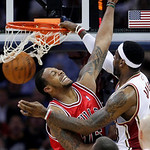 Cleveland Cavaliers&#039; LeBron James, right, dunks on Chicago Bulls&#039; James Johnson in the first quarter of Game 2 in the first round of the NBA basketball playoffs Monday, April 19, 2010, in Cl &#8230;