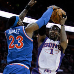 Phoenix Suns' Amare Stoudemire (1) tries to shoot over Cleveland Cavaliers' LeBron James (23) in the first quarter in an NBA basketball game Wednesday, Dec. 2, 2009, in Cleveland. The Cavali …
