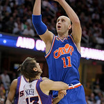 Cleveland Cavaliers' Zydrunas Ilgauskas (11), of Lithuania, scores against Phoenix Suns' Steve Nash (13) in the third quarter in an NBA basketball game Wednesday, Dec. 2, 2009, in Cleveland. …
